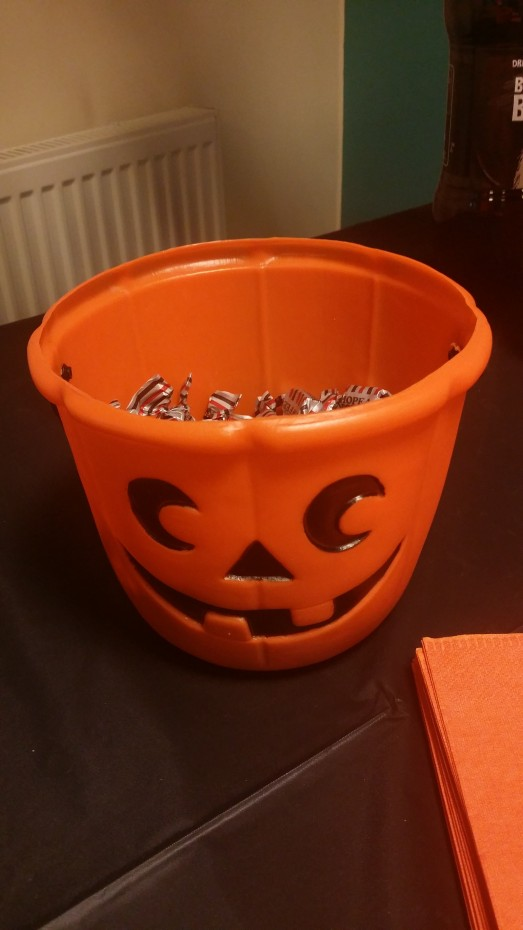 Halloween pumpkin bowl with candy