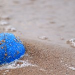 Blue Ball on the Sand Beach