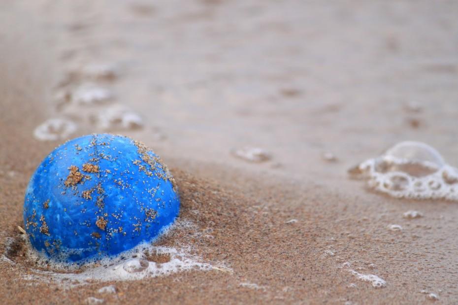 Blue Ball on the Sand Beach